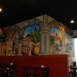 cheerful mexican scenes on the walls.