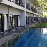 Small pool next to entrance and rooms