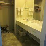 Sink/vanity area and the closet/alcove