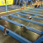 Short trampolines in the front of the pic with the longer ones in the background.