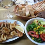 Fried fish, salad, Prosecco and bread. Delicious!