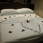 nice added touch - petals on the bed