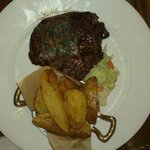 GRILLED RIB EYE OF IRISH BEEF  herb butter & chunky chips