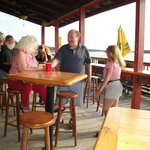 Waters Edge Pub - patrons enjoying our deck over the water.
