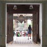 Impressive brass studded wooden entrance door.