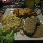 Steak covers with a divine garlic sauce