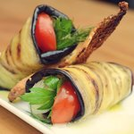 Roasted eggplant wrap with confit onion with dill and cherry tomatoes