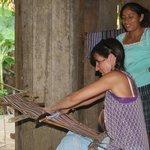 Cheryl practises weaving