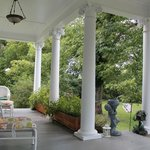 Sitting in a rocking chair on the front porch -- looking toward the left