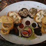 Stuffed mushrooms, garlic bread, onion rings, cheese and bacon potato halves, spicy chicken wing