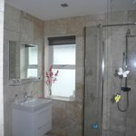 Bathroom with walk-in shower and marble tiles