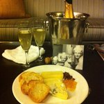 Champagne, snacks & hand written notecard from hotel staff