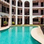 Rooms surround a lovely pool and immaculate courtyard.