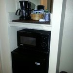 mircowave and coffee pot in the room