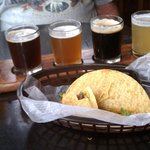a beer sampler and $1.00 tacos