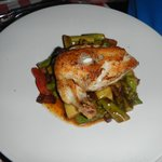 Crispy Farmers Chicken served over bed of roasted veggies