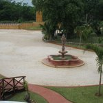 Fountain near pool, restaurant and parking area