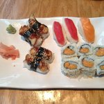 Eel sushi, spicey tuna roll, and individual piece of sushi