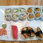 two rolls, eel sushi, and salmon sushi