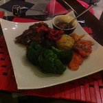 Main - Roast Lamb coated with home grown herbs & served with Seasonal Vegies and homemade mint s