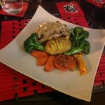 Chicken Breast stuffed with garlic & herbs, served with fresh vegies $ mushroom gravy
