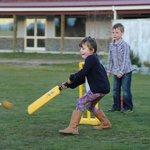Kids enjoying cricket outside Poppies Cafe