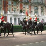 Horse Guards riding hotel in background