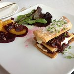 Red onion and creme fraiche millefeuille with beetroot, orange and cumin salad