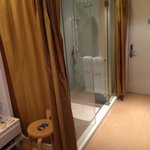 glassed bathroom with courtesy curtains