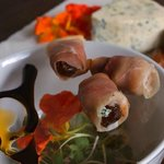 Dates with blue cheese and procuitto