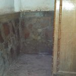 dilapidated bathroom with no hot water or functional toilet