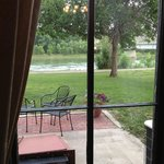looking out from dining room to patio where dinner and drinks can be served.  Missouri River vie