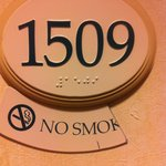 "broken ""no smoking"" sign outside our room"