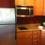 full size fridge, microwave, & 2 burner cooktop