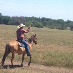 Whilst out on a trail ride. Dale one of the wranglers demonstrating roping.