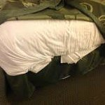 Sheets were jammed under the matress at the foot of the bed