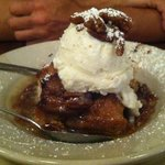 bread pudding with ice cream and pecans