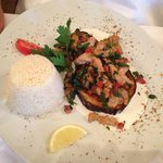 Chicken with mint and tomatoes on aubergine