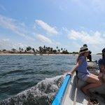Boat trip to local Kiwayu village