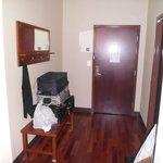 wood floor by door/bathroom