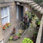 Arrive through the lovely below-street gardens.