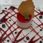 Strawberry cheesecake with basil jelly and black olive puree.