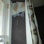 Room 8 - peeling wallpaper due to damp