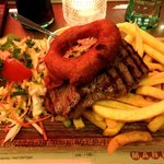 Steak, chips, salad, and onion rings.