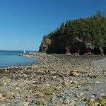 Rocky beach adjacent to lighthouse