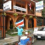 "Street vendor, Manual, sells ""agua pipa""  (fresh coconut juice)"