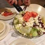 "The Luigi's ""Greek"" salad - this is a full portion, they also serve half."