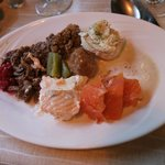 Mixed starters and main course of reindeer meat, elks meatball