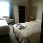 Room 8 with queen and single beds with share bath facilities