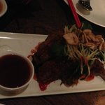 Crispy beef ribs with pomegranate sauce